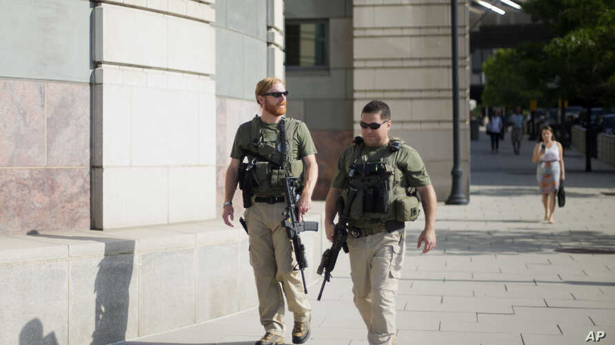 US Marshals patrol the area outside federal court in Washington, July 2, 2014, where Libyan militant Ahmed Abu Khattala, charged in the deadly attack at the U.S. diplomatic outpost in Benghazi, is being held for a detention hearing.