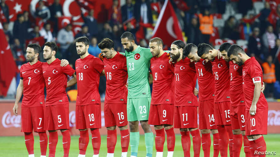 Turkey's players observe a minute of silence for the victims of the Paris attacks before their soccer match Nov. 17, 2015, against Greece in Istanbul.