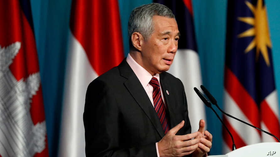 Singapore's Prime Minister Lee Hsien Loong speaks during a press conference to mark the end of the 32nd ASEAN Summit, April 28, 2018, in Singapore.