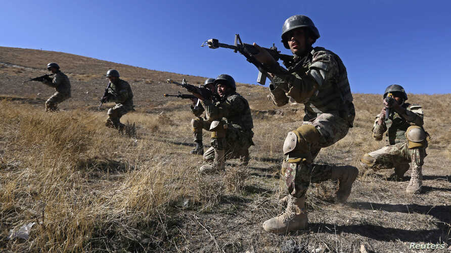 Afghan National Army (ANA) soldiers take part in a training exercise at a military base in Kabul November 23, 2014.
