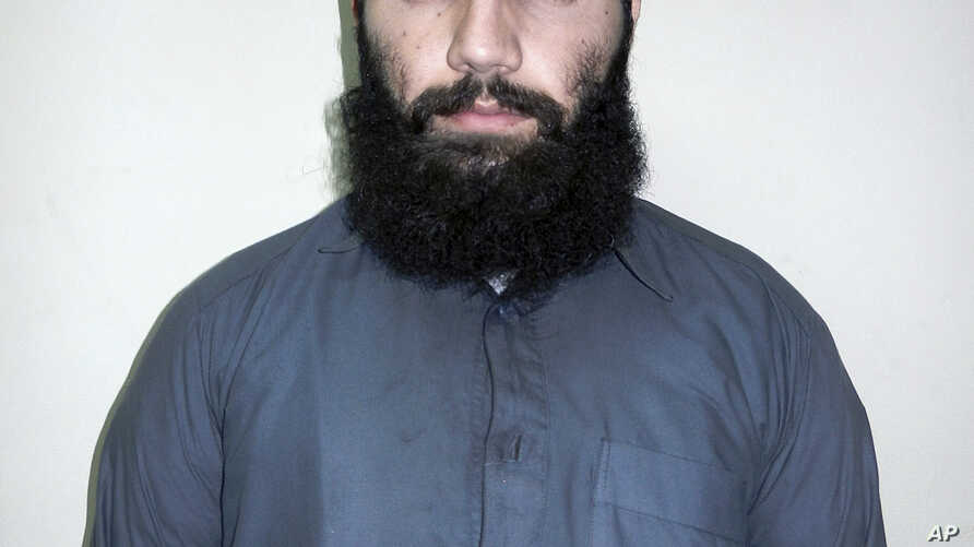 Anis Haqqani, a senior leader of the al-Qaida-linked Haqqani network and a brother of the network's leader Sirajuddin Haqqani, poses for a picture in Kabul, Afghanistan, Oct. 15, 2014.