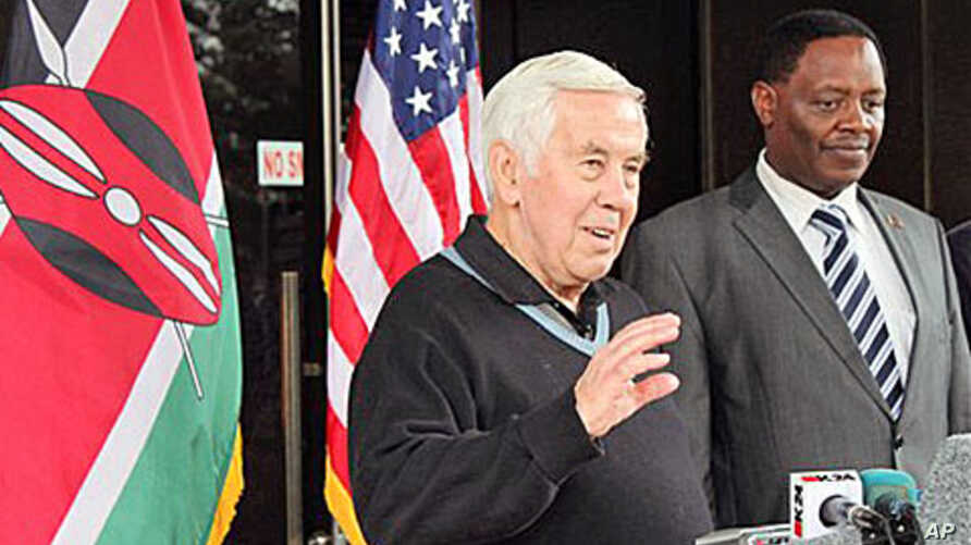 U S. Senator Dick Lugar, left, stands next to Dr. Solomon Mpoke, director of the Kenya Medical Research Institute speaks to journalists in Nairobo, Kenya