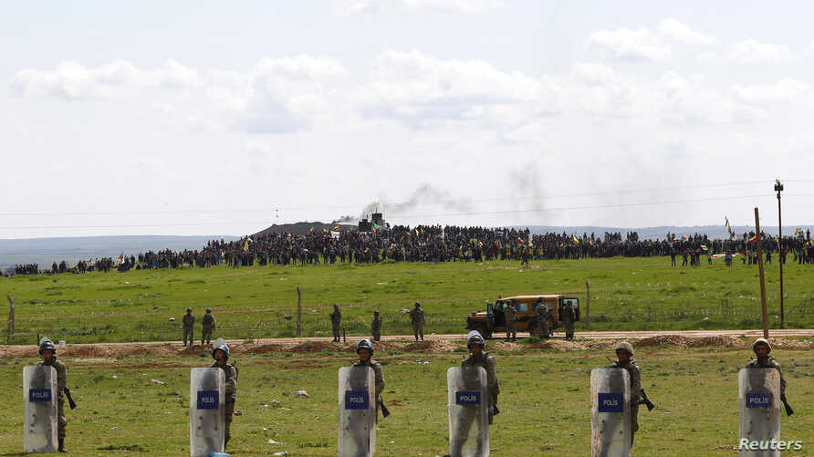 FILE - Turkish soldiers secure the border line between Turkey and Syria near the town of Suruc, Sanliurfa province, March 17, 2015.