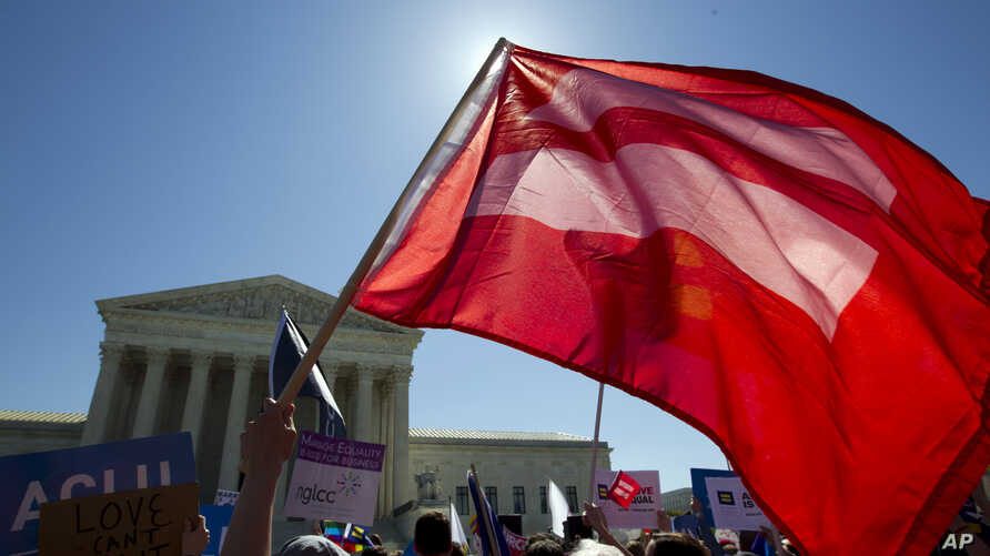 An equality flag waves during a demonstrators in front of the Supreme Court in Washington, D.C., April 28, 2015.