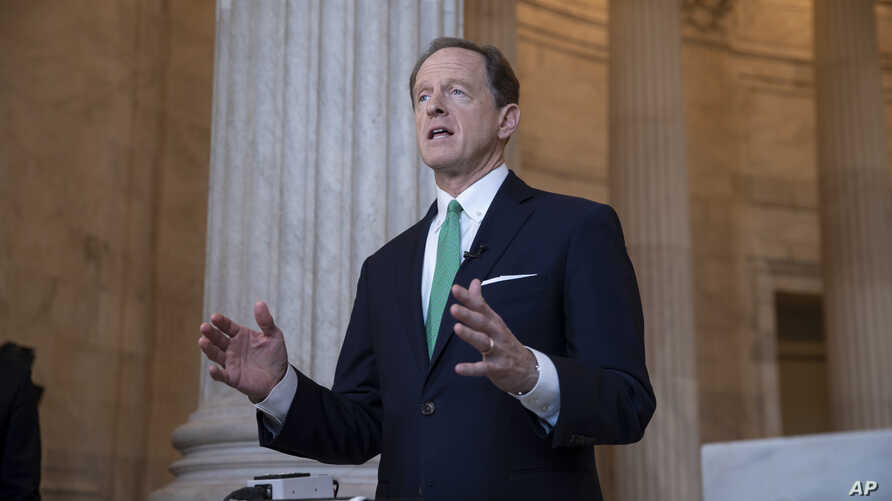 Sen. Pat Toomey, R-Pa., discusses President Donald Trump's revamped North American trade agreement with Canada and Mexico during a television news interview on Capitol Hill in Washington, Oct. 2, 2018.