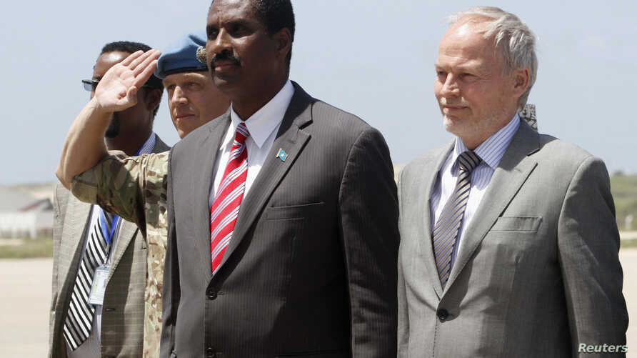 The United Nations envoy for Somalia, Nicholas Kay (R), is welcomed by Somalia's Information Minister Abdullahi Ilmoge at the airport in Somalia's capital Mogadishu, June 2013.