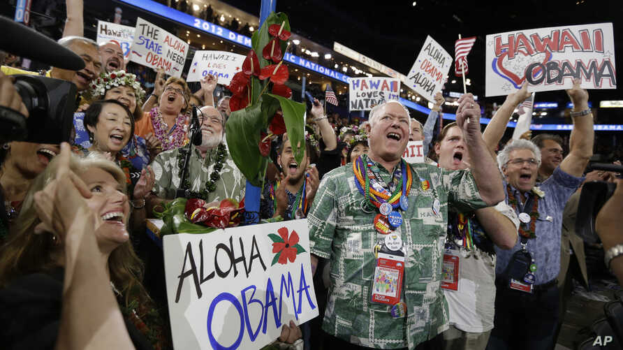 Hawaii delegates react as President Barack Obama is nominated for the Office of the President of the United States at the Democratic National Convention in Charlotte, N.C., September 5, 2012.