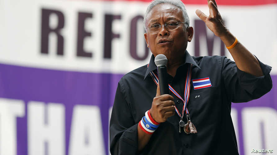 Protest leader Suthep Thaugsuban addresses anti-government protesters in their encampment in central Bangkok, Feb. 25, 2014.