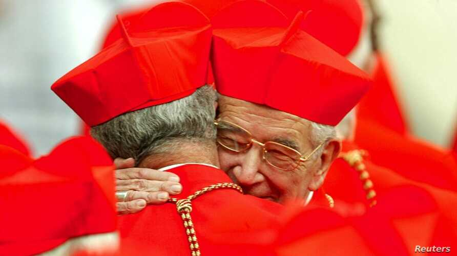 Cardinal Rodolfo Quezada Toruno (R) of Guatemala hugs a colleague during the consistory led by Pope John Paul II in Saint Peter's Square at the Vatican (October 2003 file photo).