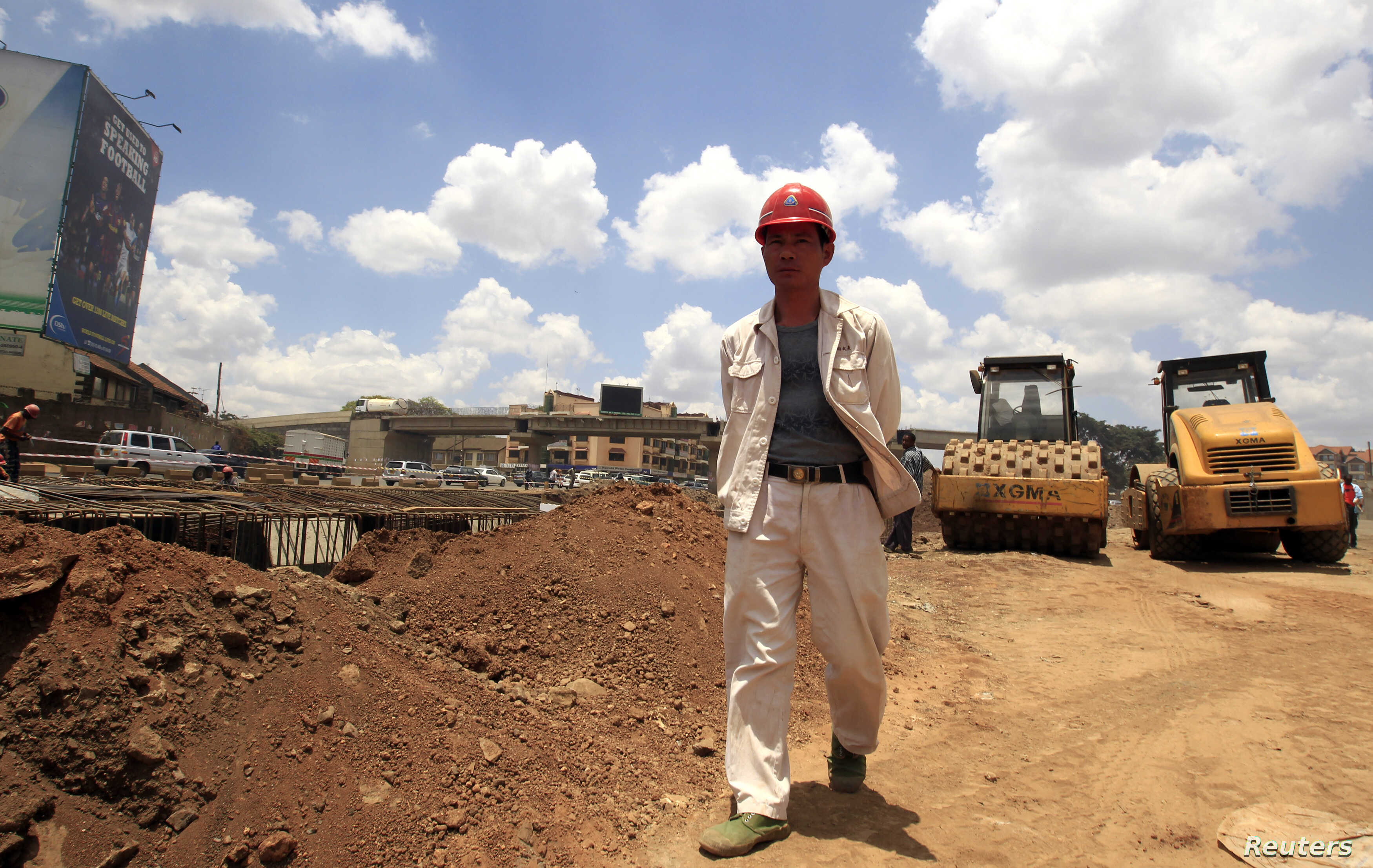 A site manager from China Wuyi, Sinohydro and Shengeli Engineering Construction Group checks progress on Kenya's Nairobi-Thika highway project in 2011. The $28 billion road is paid for by China, Kenya and the African Development Bank.