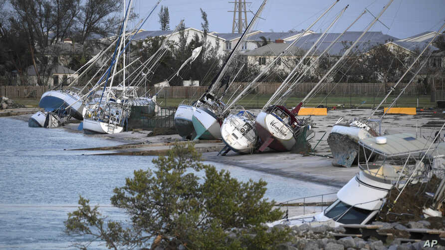 Damaged sail boats are shown in the aftermath of Hurricane Irma, Sept. 11, 2017, in the Florida Keys.