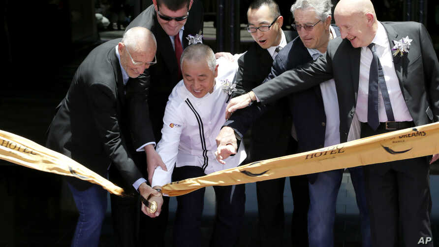 Hollywood actor Robert  De Niro, second from right, joins his partners Japanese culinary Chef Nobu Matsuhisa, third from left, Hollywood film producer Meir Teper, left, and Melco Crown Entertainment casino executives James Packer, second from left, a