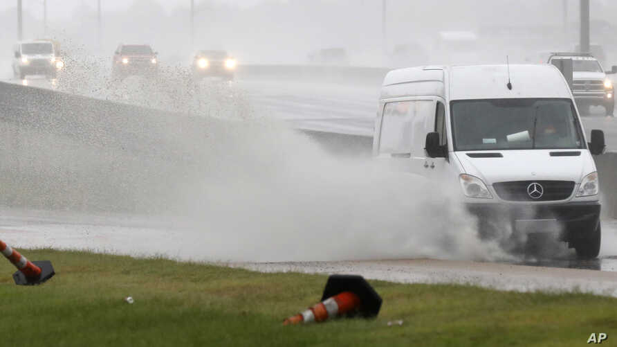 Accumulated rain from what became Tropical Depression Gordon makes for a big splash as this service van makes its way across a frontage road along Interstate 55 in Jackson, Miss., Sept. 5, 2018. Weather forecasts have much of the central part of the
