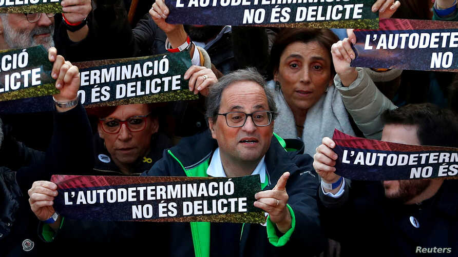 FILE - Catalan Regional President Quim Torra takes part during a rally of Catalan separatist organizations to demonstrate against the trial of Catalan leaders and call for self-determination rights in Barcelona, Spain, Feb. 16, 2019.