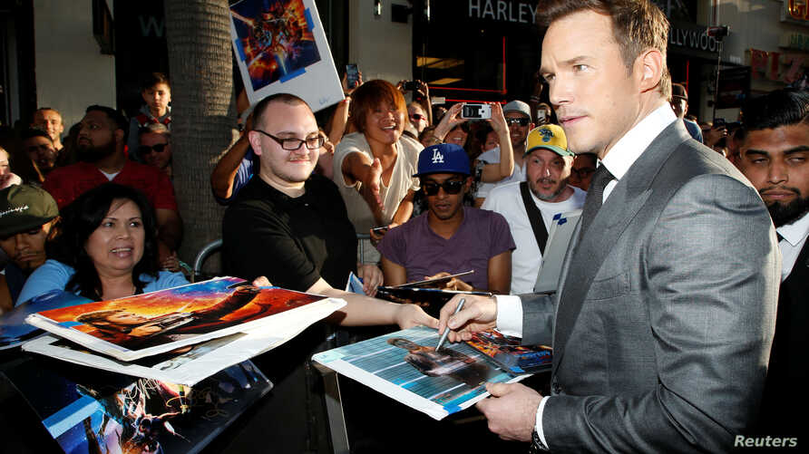 """Actor Chris Pratt signs autographs at the world premiere of Marvel Studios' """"Guardians of the Galaxy Vol. 2."""" in Hollywood, April 19, 2017."""