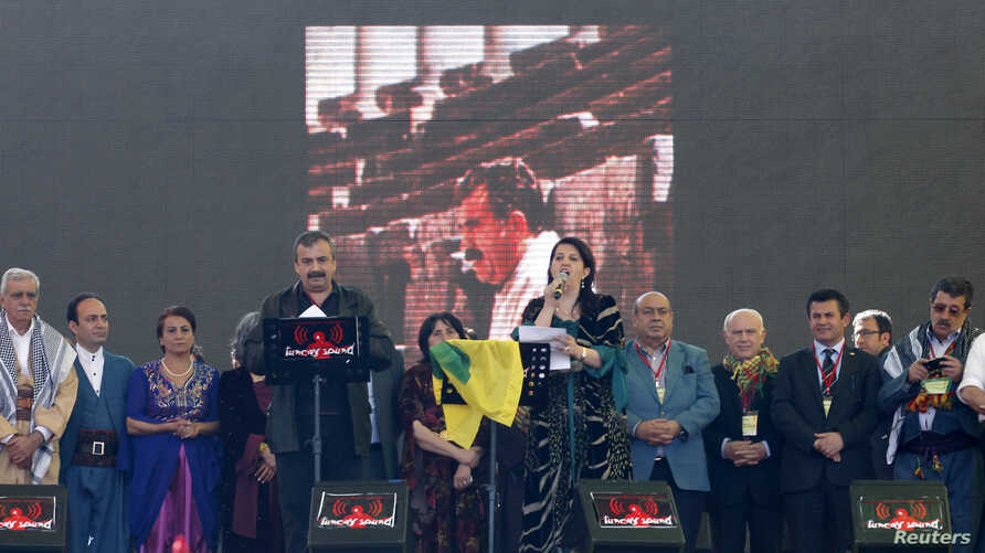 Pro-Kurdish politicians Sirri Sureyya Onder (3rd L) and Pervin Buldan (6th R) read the statement of jailed Kurdish rebel leader Abdullah Ocalan as they are flanked by other Kurdish politicians in the southeastern Turkish city of Diyarbakir, March 21,