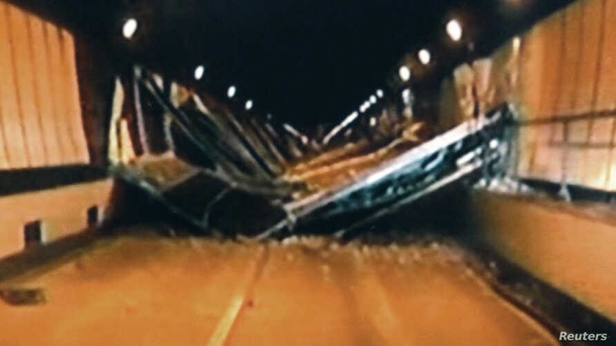 Broken concrete ceiling panels are seen after collapsing inside Sasago Tunnel on the Chuo Expressway in Yamanashi Prefecture, in this handout still image taken from video by Yamanashi Prefectural Police on December 2, 2012, and released by Kyodo Dece