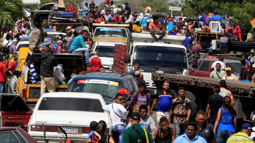 Venezuelans line up to cross into Colombia at the border in Paraguachon, Colombia, Feb. 16, 2018.