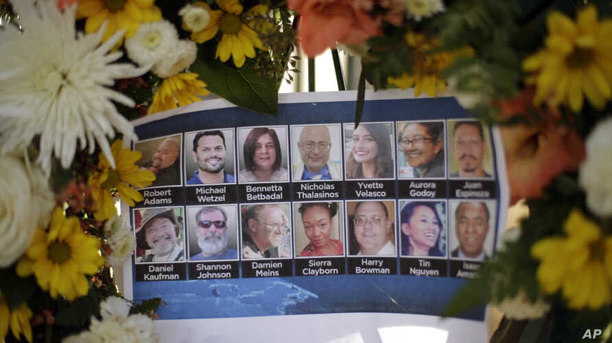 FILE - Pictures of Wednesday's shooting victims are displayed at a makeshift memorial site in San Bernardino, Calif., Dec. 7, 2015.