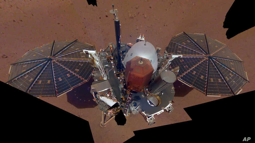FILE - Image made available by NASA and assembled from 11 photos shows the InSight lander, Dec. 6, 2018.