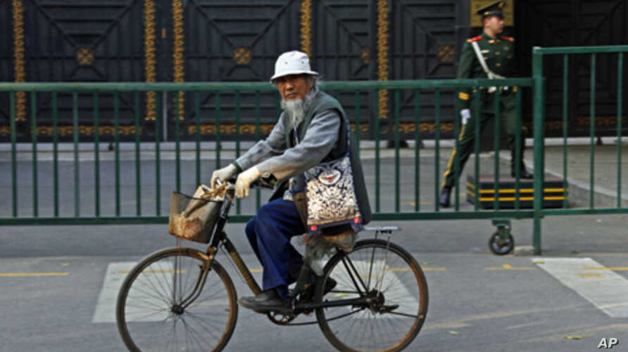 A Chinese man rides his bicycle past the North Korean embassy in Beijing, November 5, 2010.