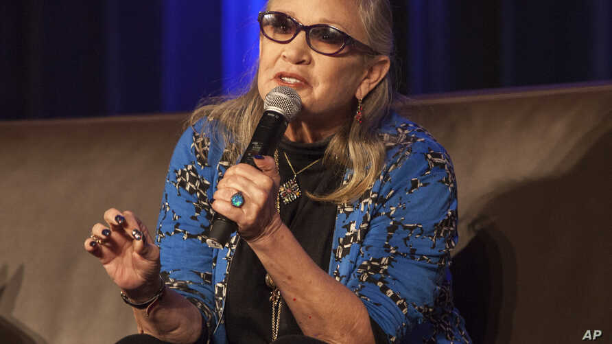 Carrie Fisher speaks during Wizard World Chicago Comic-Con at the Donald E. Stephens Convention Center in Chicago, Aug. 21, 2016.