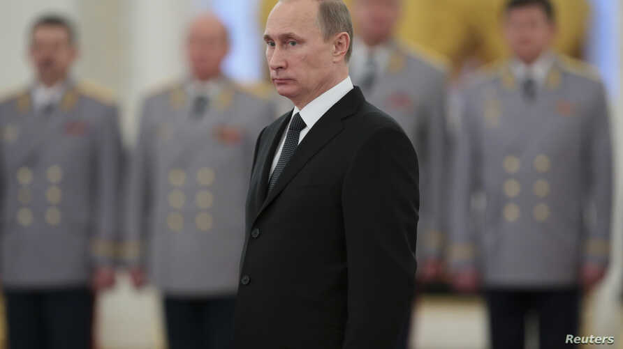 Russia's President Vladimir Putin attends a ceremony to present officers, who were recently appointed to senior command positions, at the Kremlin in Moscow, Nov. 19, 2013.