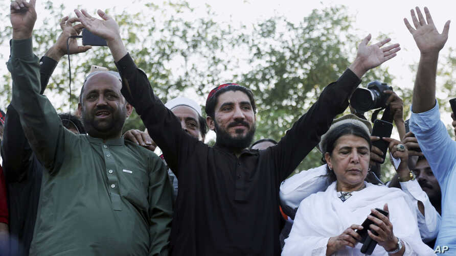 Manzoor Pashteen, center, a leader of the Pashtun Protection Movement waves to his supporters during a rally in Lahore, Pakistan, April 22, 2018.