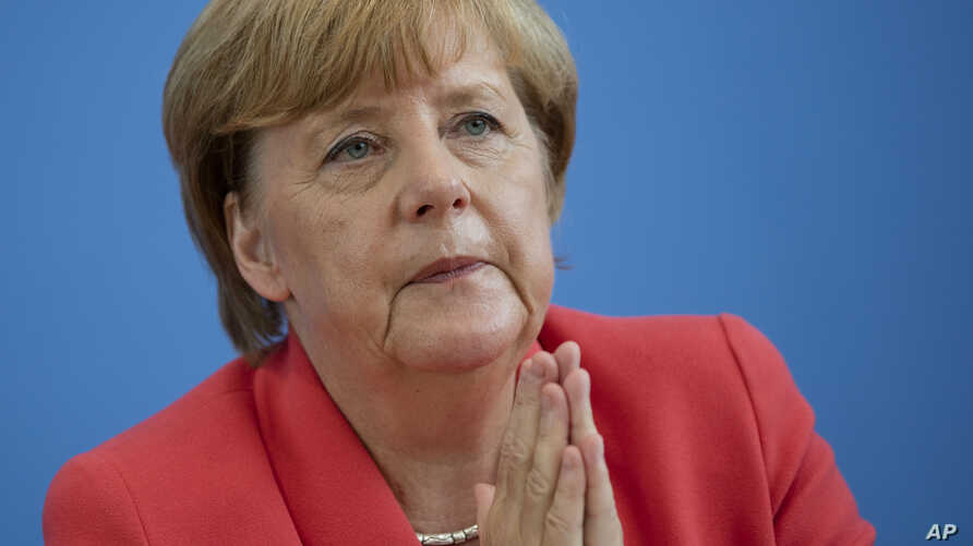German Chancellor Angela Merkel gestures during her annual summer news conference in Berlin, Germany, Aug. 31, 2015.