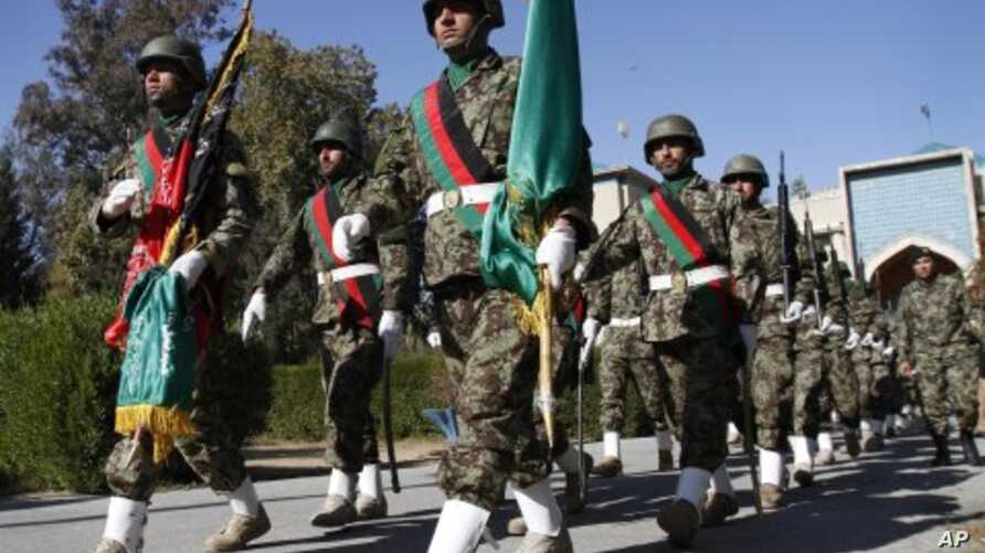 Afghan soldiers march during the second phase of transfer of authority ceremony from the NATO-led troops to Afghan security forces in Jalalabad, Nangarhar province, east of Kabul, Afghanistan, January 26, 2012.