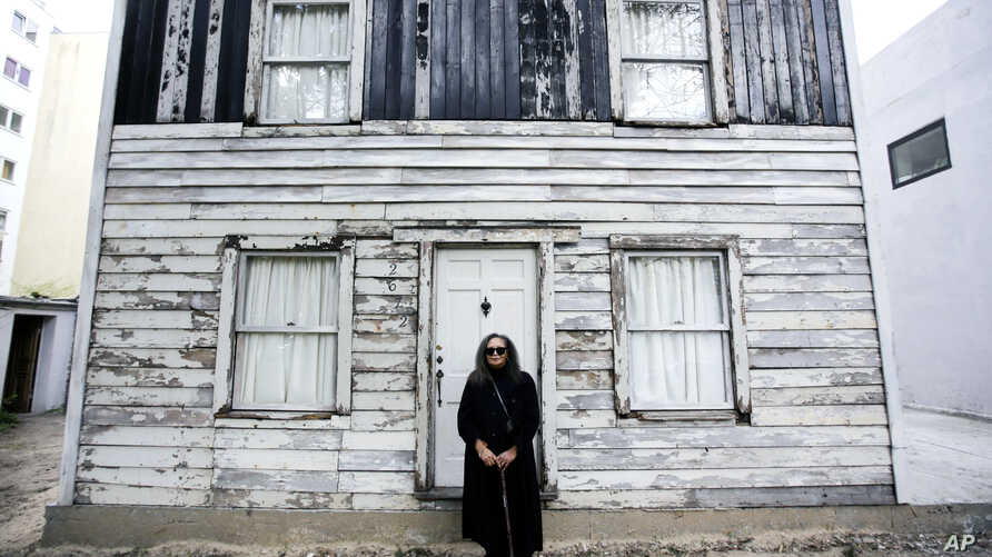 FILE - Rhea McCauley, a niece of the late civil rights icon Rosa Parks, poses in front of Parks' rebuilt house in Berlin, Germany, April 6, 2017.