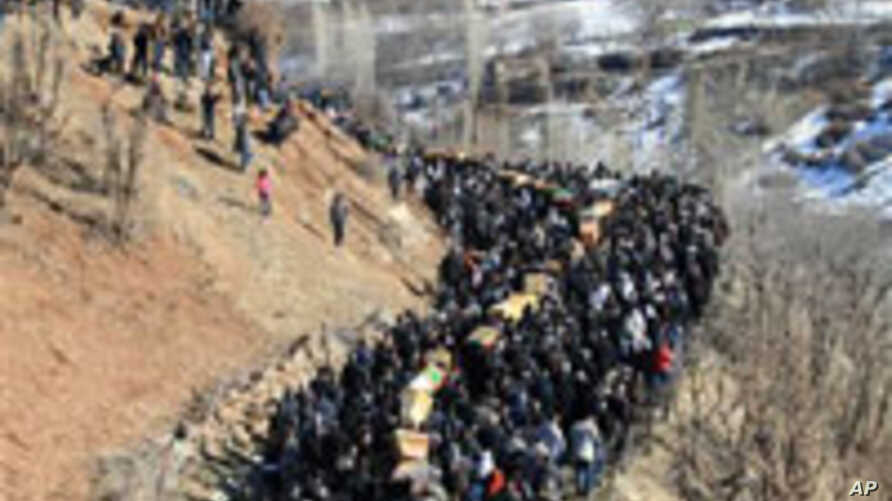 Thousands of mourners gathered in Turkey's Gulyazi village Dec. 30, 2011 for funerals of 35 Kurdish civilians killed in raid by Turkish military jets