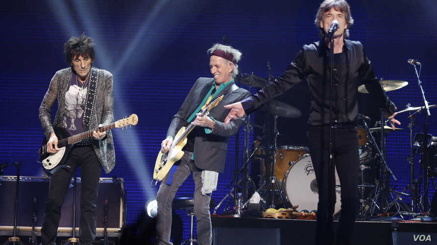 FILE - Ronnie Wood, left, Keith Richard, center, and Mick Jagger of the Rolling Stones perform in concert at the TD Garden arena on Wednesday, June 12, 2013 in Boston.