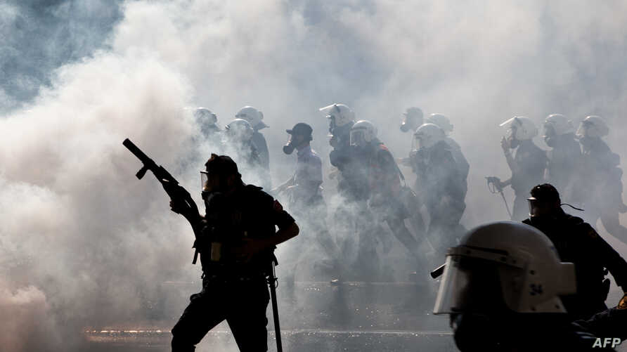 Turkish police clash with protestors at a May Day demonstration in Istanbul, May 1, 2013.