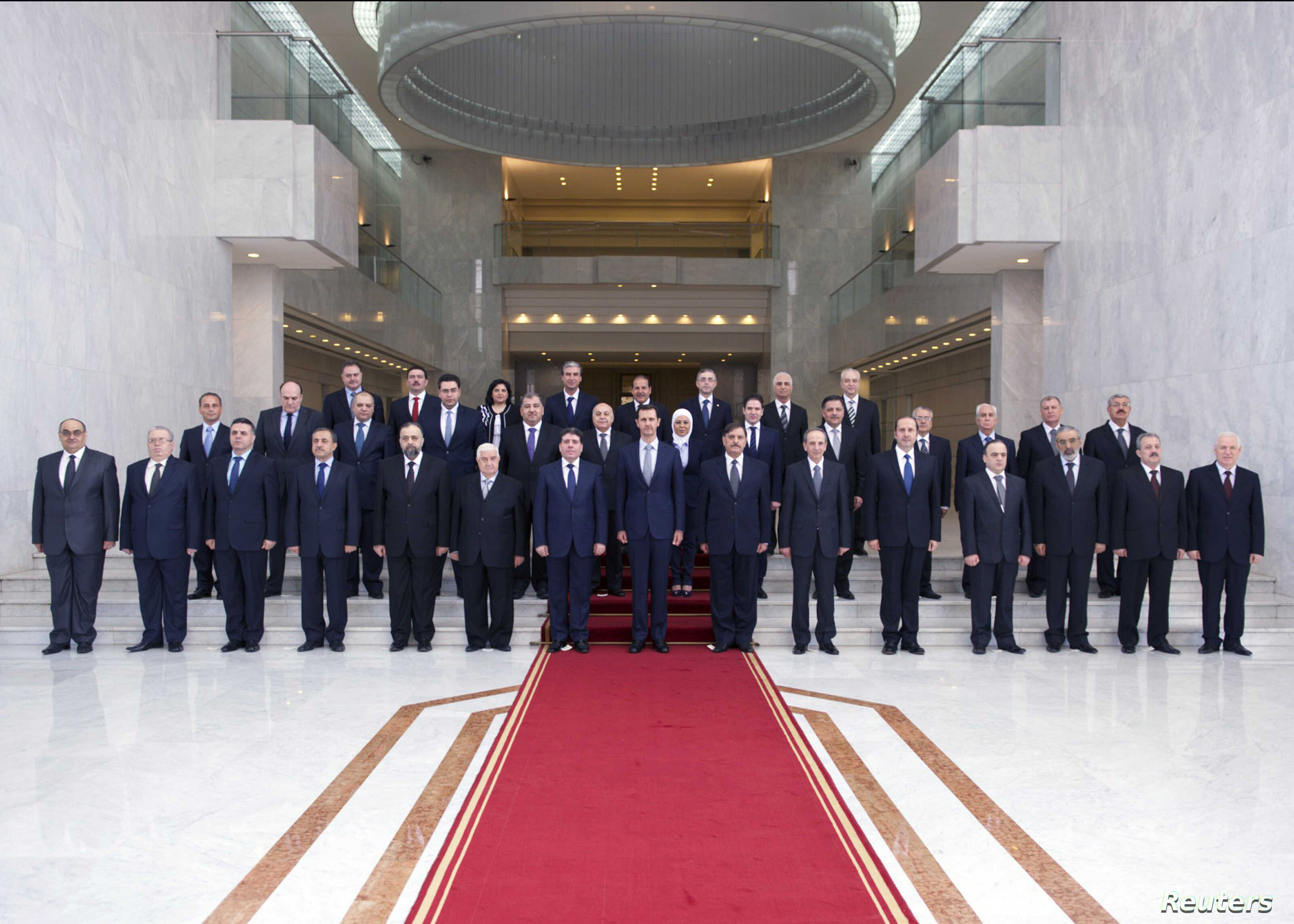 Syria's President Bashar al-Assad (front C) poses with members of his new cabinet in Damascus, Aug. 31, 2014.