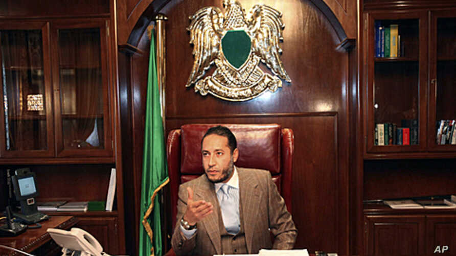 Saadi Gadhafi, a son of Libyan leader Moammar Gadhafi, speaks during a news conference at his office in Tripoli, January 31, 2010.