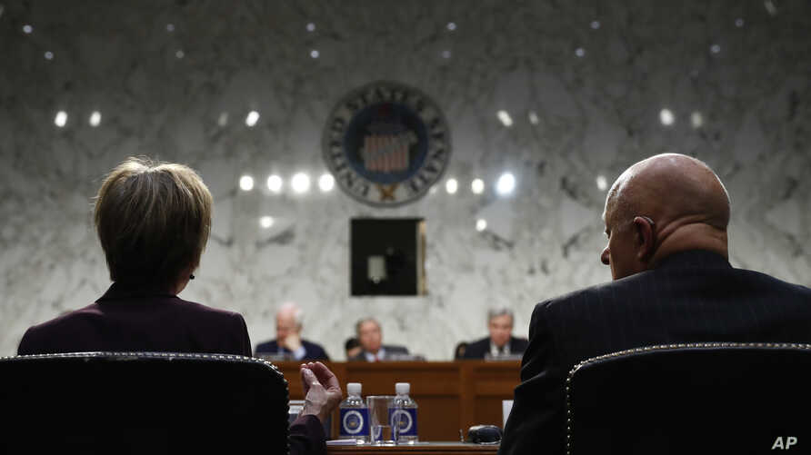 Former acting Attorney General Sally Yates, left, and former National Intelligence Director James Clapper, testify on Capitol Hill in Washington, May 8, 2017.