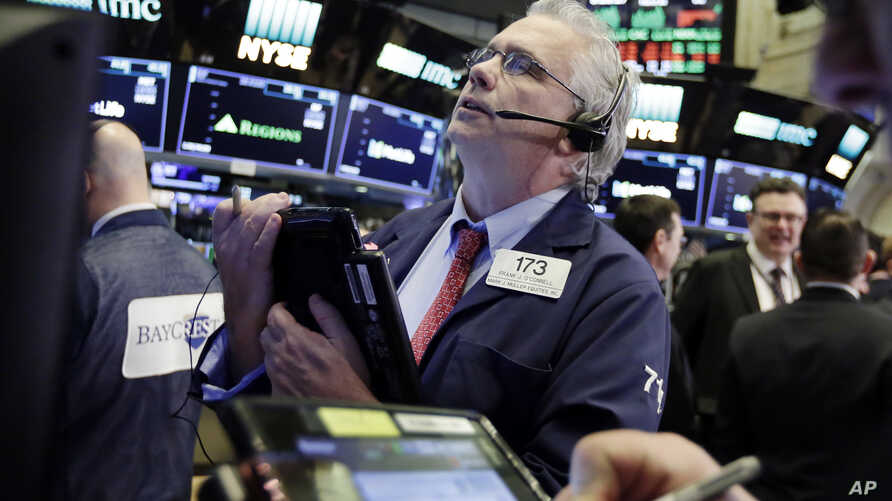 Trader Fran O'Connell works on the floor of the New York Stock Exchange, March 26, 2018. U.S. stocks rose sharply in early trading Monday as the market made up some of its huge losses from last week.