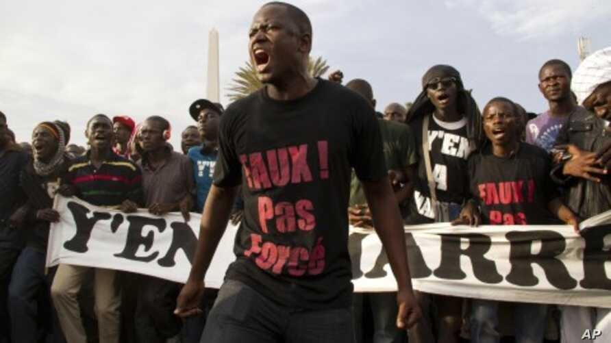 Protesters opposed to President Abdoulaye Wade running for a third term shout slogans during a rally in Dakar, Senegal, January 31, 2012.