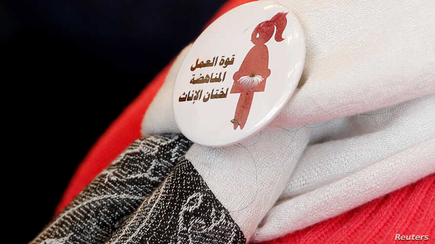 "A badge reads ""The power of labor aginst FGM"" is seen on a volunteer during a conference on International Day of Zero Tolerance for Female Genital Mutilation in Cairo, Egypt, Feb. 6, 2018."