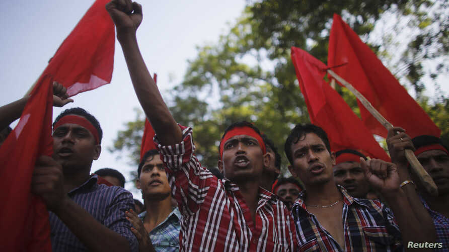 Activists and garment workers shout slogans during a protest demanding a minimum wage of 8,000 Bangladeshi Taka [$100] in Dhaka, Bangladesh, Nov. 8, 2013.