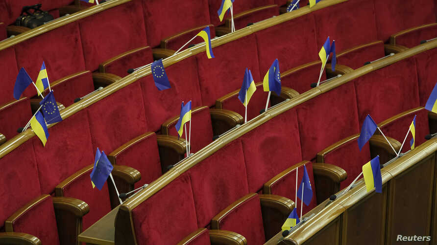 Ukrainian and EU flags are seen before a session of parliament in Kyiv Nov. 21, 2013.