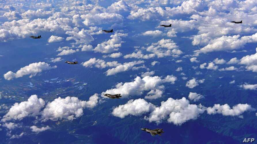 South Korean F-15K fighter jets and US F-35B stealth jet fighters fly over South Korea during a joint military drill aimed to counter North Korea's latest missile test,  Aug. 31, 2017. Handout photo provided by South Korean Defense Ministry.