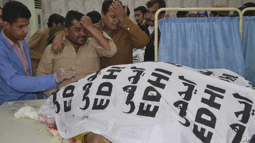 People mourn the death of a police officer and his family members, at a hospital in Quetta, Pakistan, Nov. 15, 2017.