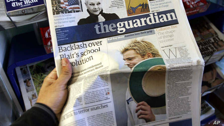 FILE - Britain's daily newspaper The Guardian is seen at a market in London.
