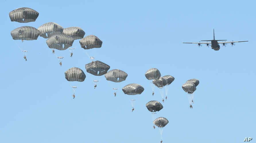 Airborne forces from the U.S., Great Britain and Poland conduct a multi-national jump on to a designated drop zone near Torun, Poland, June 7, 2016. The exercise, Swift Response-16, sets the stage in Poland for the multi-national land force training