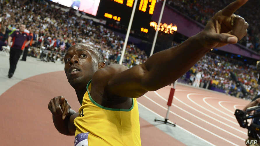 Jamaica's Usain Bolt reacts after winning the men's 100 meters race, August 5, 2012.