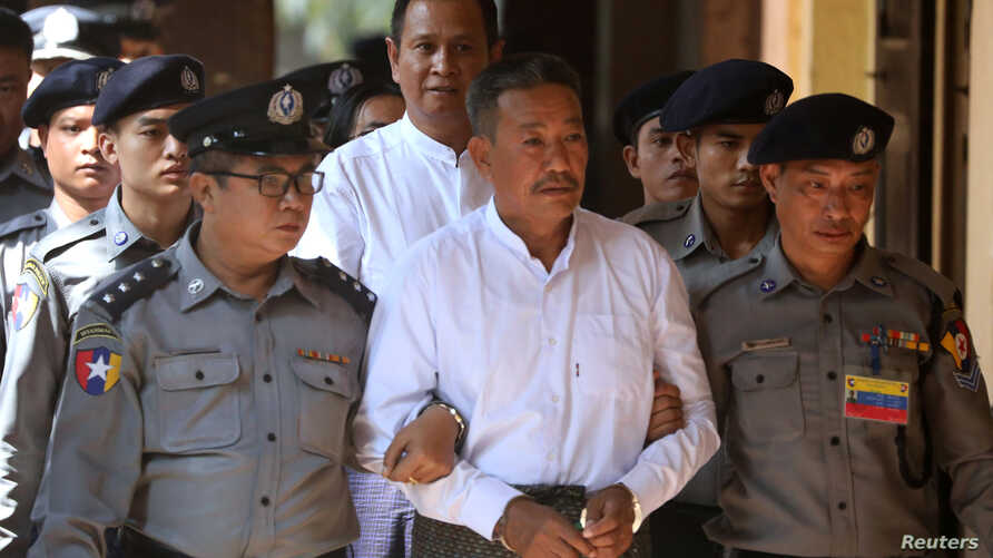 Kyi Lin, center, and Aung Win Zaw, who are accused of the murder of Muslim lawyer Ko Ni, arrive at Insein court in Yangon, Myanmar, Feb. 15, 2019.