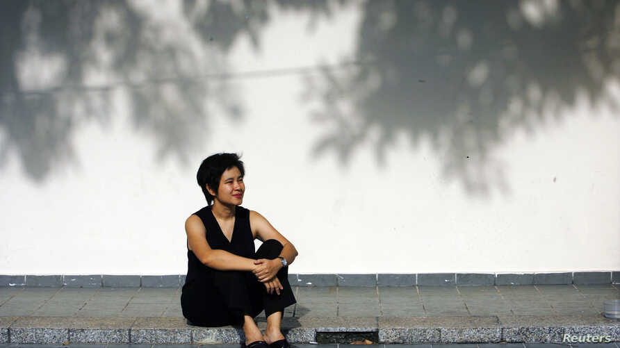 "Filmmaker Tan Pin Pin poses during a 2007 photo shoot in Singapore.  Her film, ""To Singapore, with Love"" was banned by the government in Singapore."