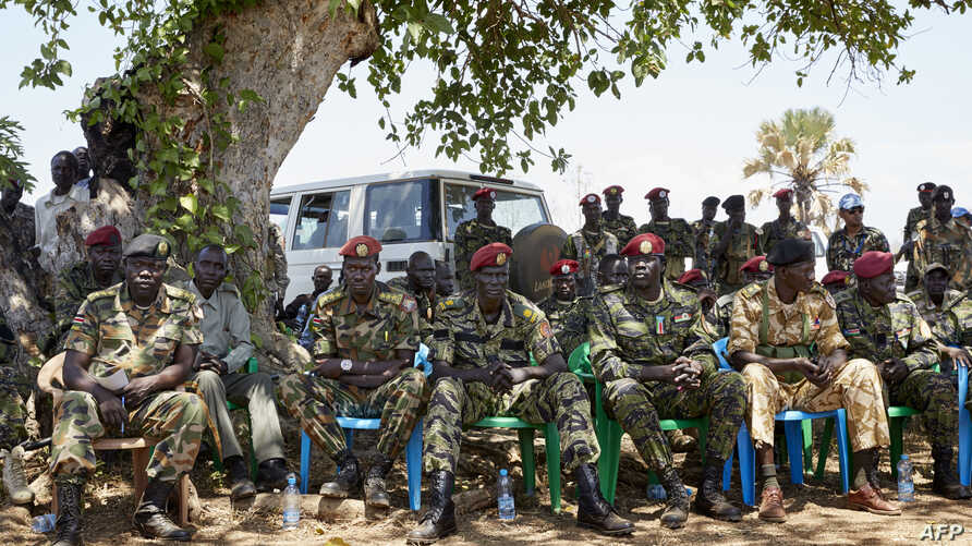 FILE - Members of the SSPDF special forces Tiger Batallion gather in Pageri, S. Sudan on Feb. 14, 2019.  Members of SSPDF and their ex-rivals, SPLA-IO, gathered in Pageri to continue peace talks.